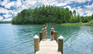 Featured image: Children playing at dock - Read full post: Preventing Electric Shock Drowning with Bender's MarinaGuard®
